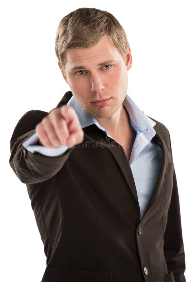 Ung manlig affärsledare som pekar på dig royaltyfria bilder