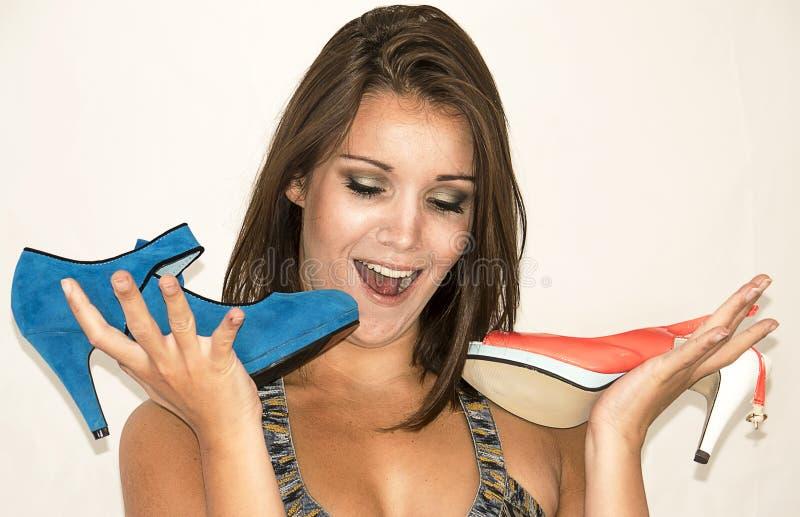 Ung nätt kvinna med skor royaltyfria bilder