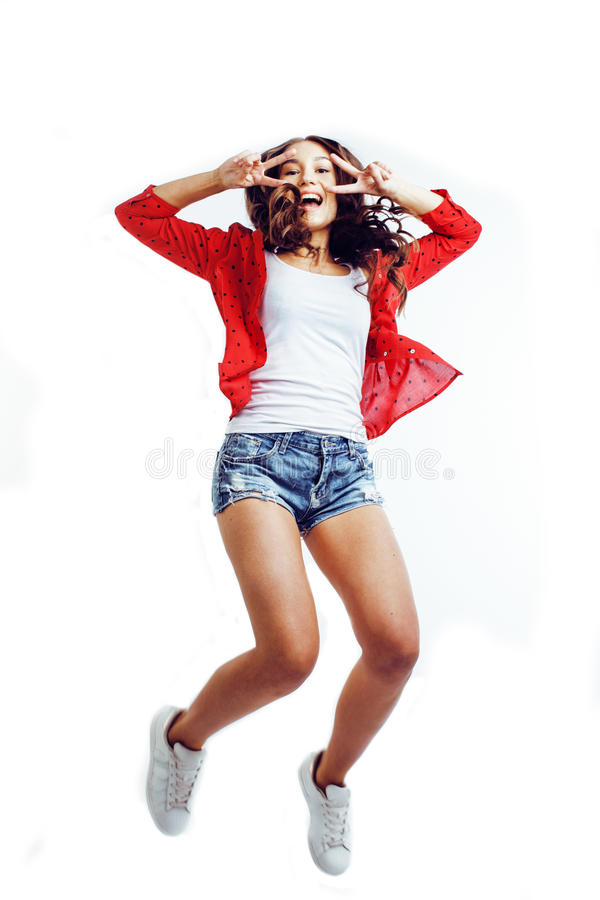 Ung nätt tonårs- flicka som hoppar gladlynt som isoleras på vit bakgrund, livsstilfolkbegrepp fotografering för bildbyråer