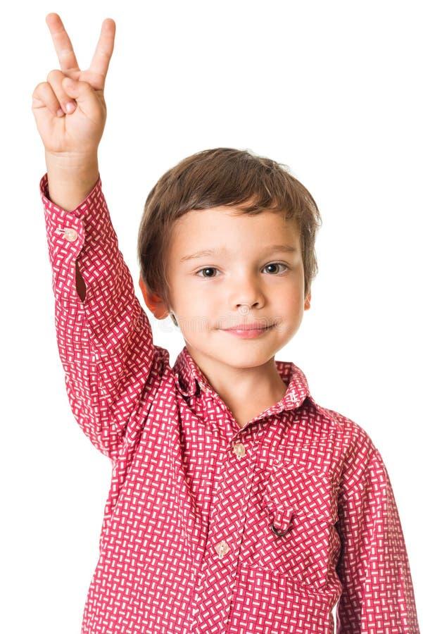 Ung pojke med den lyftta handen arkivfoton