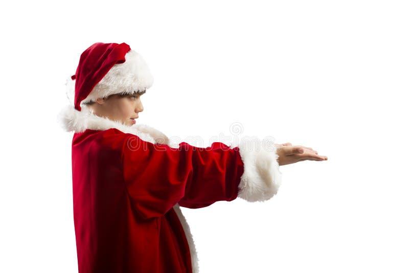 Ung pojke som är klar att motta en julklapp arkivbild