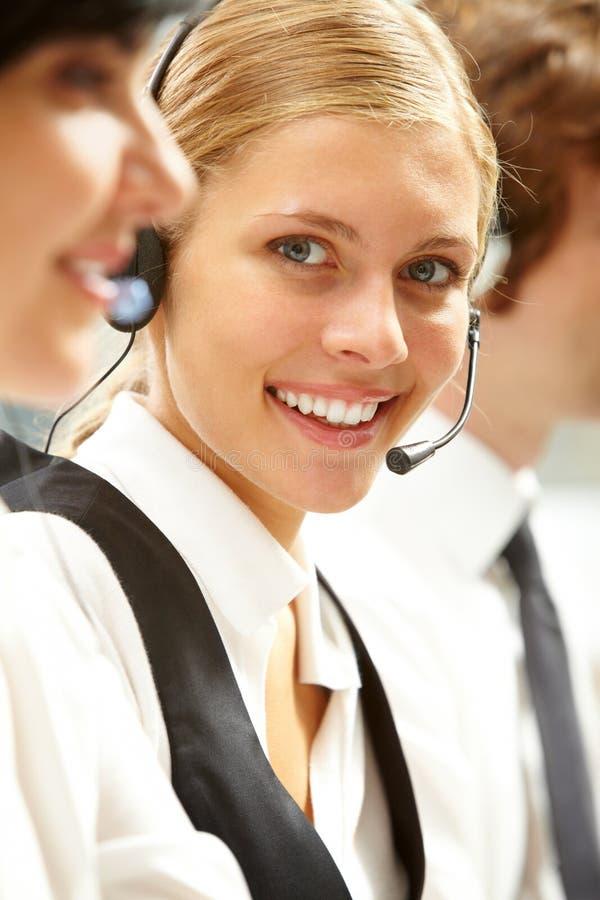 Ung receptionist arkivfoton