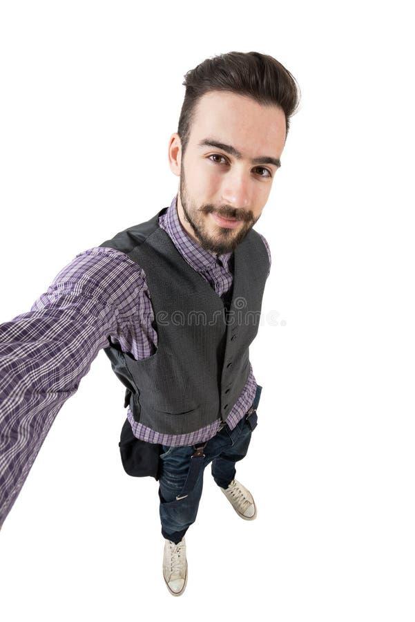 Ung rolig lycklig hipster som tar självståenden eller selfie arkivbild
