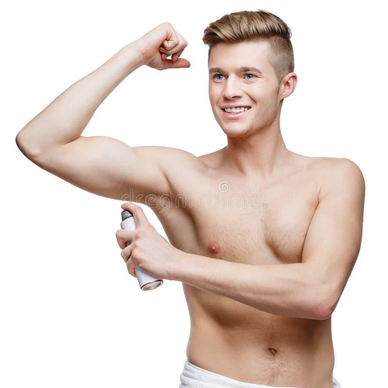 Ung shirtless man som isoleras på vit arkivfoto