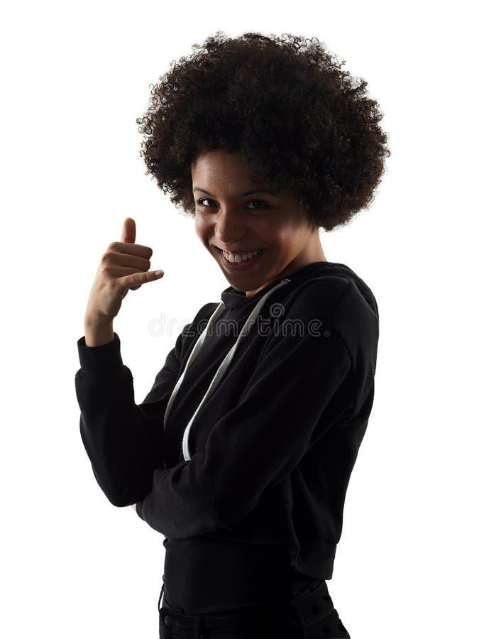 Ung skugga för tonåringflickakvinnan kallar mig gestkonturisolator royaltyfri bild