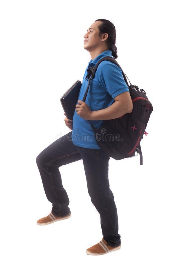 Ung student Stepping Forward Isolated p? vit arkivbilder