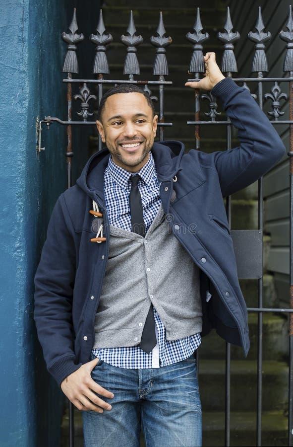 Ung svart man med staket för wrought järn royaltyfria foton