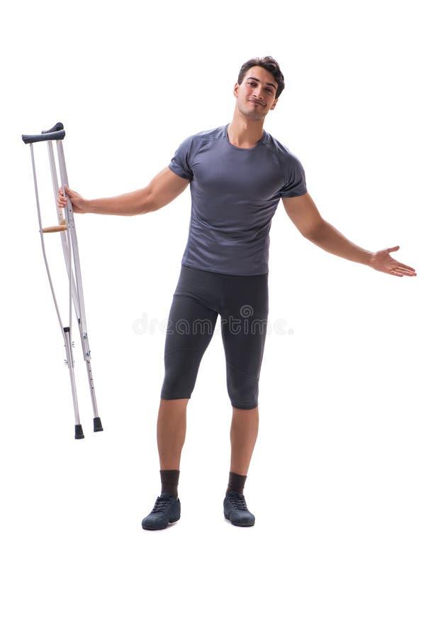 Ung tålmodig idrottsman nenidrottsman som lider en skadatrauma med royaltyfri foto