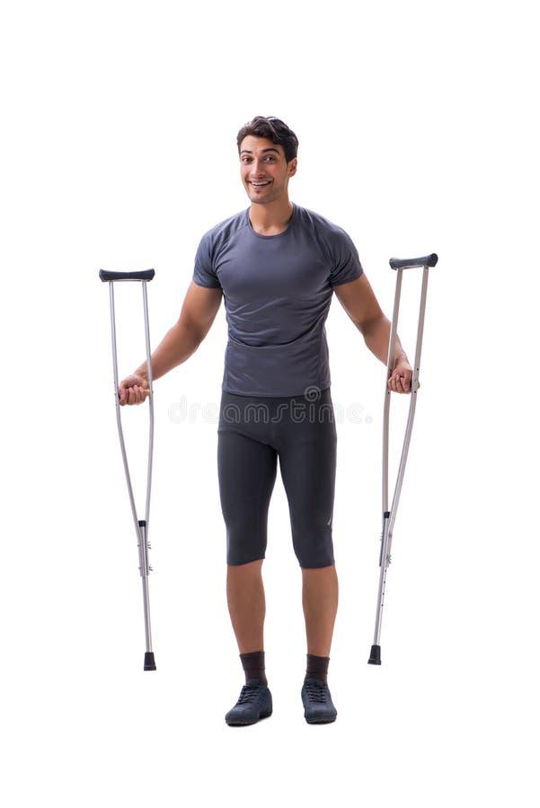 Ung tålmodig idrottsman nenidrottsman som lider en skadatrauma med arkivfoton