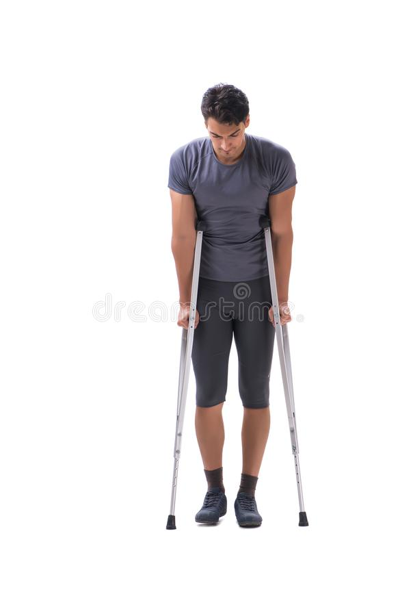 Ung tålmodig idrottsman nenidrottsman som lider en skadatrauma med arkivbilder