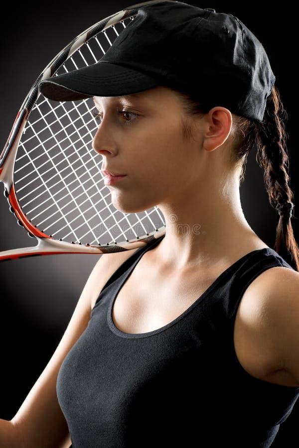 Ung tennisspelarekvinna med racket royaltyfria foton