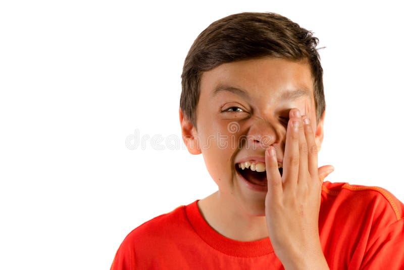 Ung tonårs- pojke som isoleras på vit royaltyfria foton
