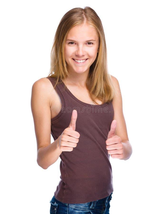 Unga flickan visar tummen övre gest arkivbild