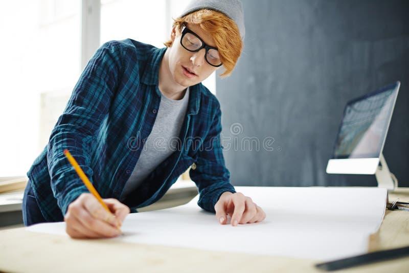 Unga Ginger Designer Drawing Sketches arkivbilder