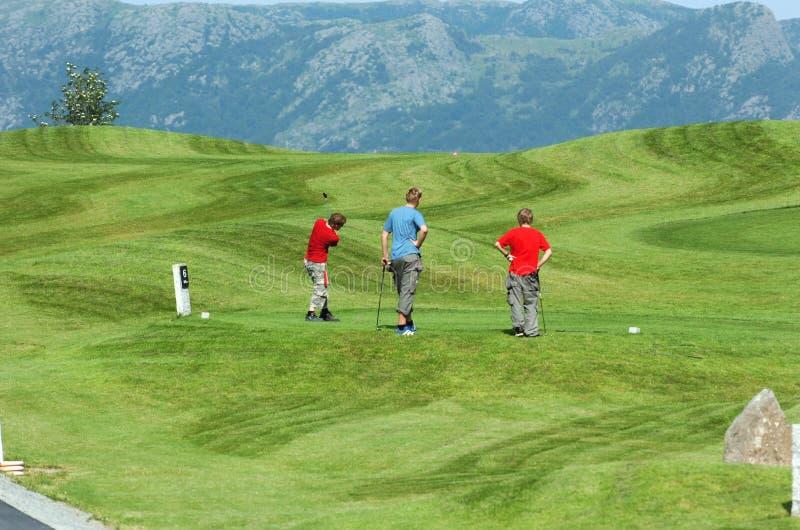 unga golfare arkivbild