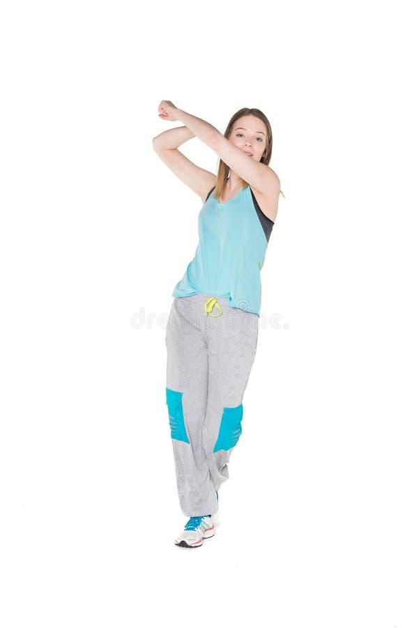 Unga kvinnor i joggers som dansar och har gyckel arkivbilder