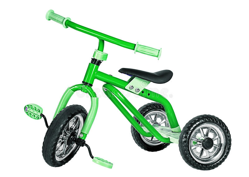 Ungar gör grön trehjulingen arkivfoto
