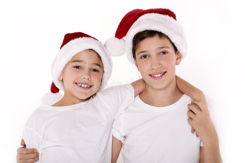Ungar i den Santa Claus hatten arkivfoton