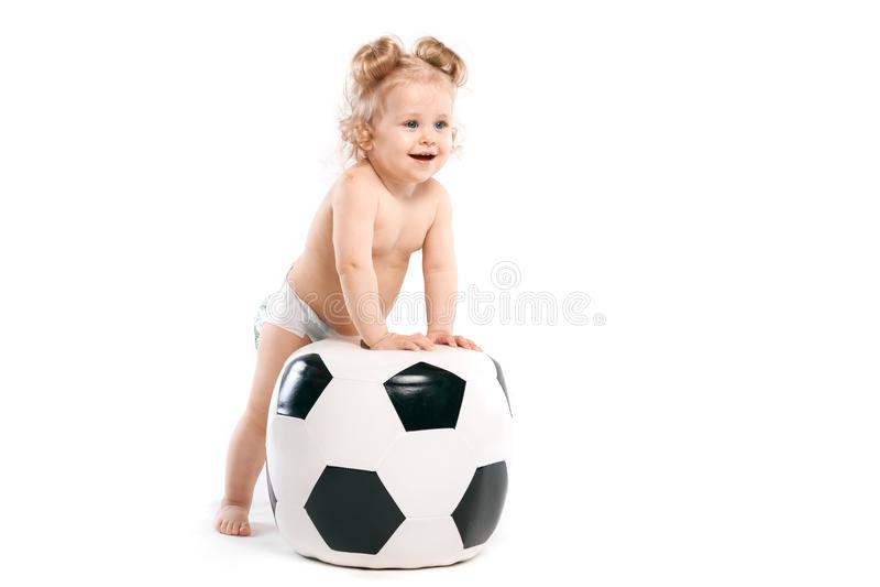 Unge med en stor boll, fotbollfan royaltyfria bilder