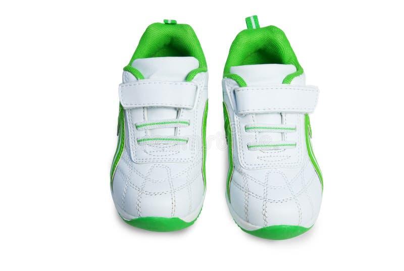 unge s shoes sporten arkivbild