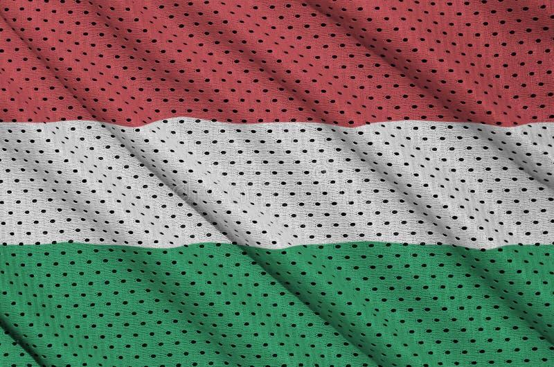Ungernflaggan skrivev ut på ett tyg för ingrepp för polyesternylonsportswear royaltyfri foto