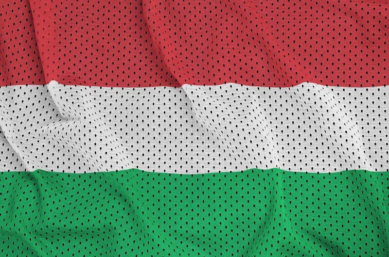 Ungernflaggan skrivev ut på ett tyg för ingrepp för polyesternylonsportswear arkivfoto