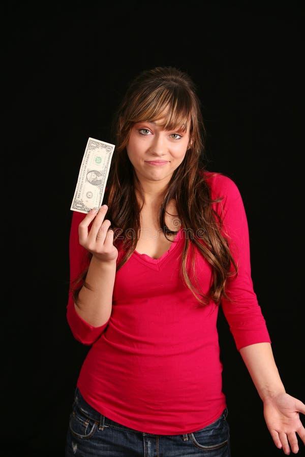 Unglückliches Mädchen mit Dollarschein stockfoto