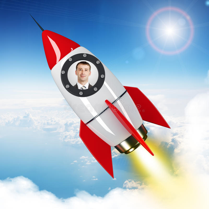 Ungt affärsmanflyg i himmel på den utdragna raket royaltyfria bilder