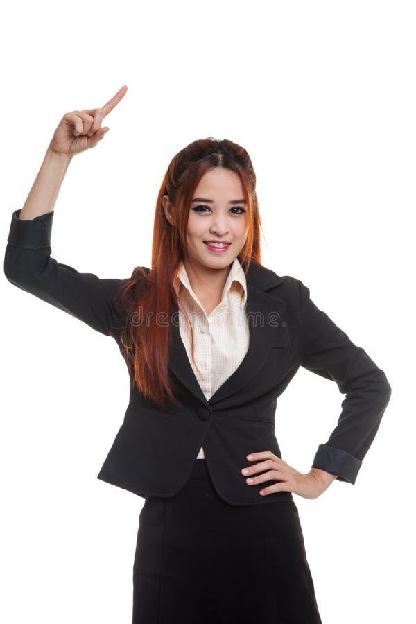 Ungt asiatiskt affärskvinnaleende och punkt upp arkivbilder
