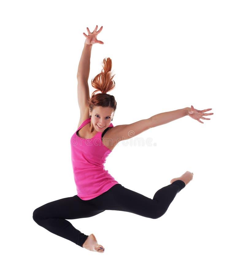Ungt kvinnahopp för skönhet i acrobatic dräkt royaltyfria bilder