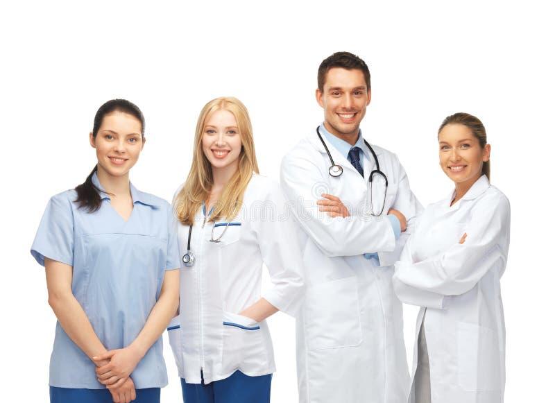 Ungt lag eller grupp av doktorer arkivfoto