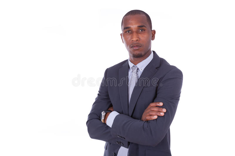 Unhappy African american business man with folded arms over whit royalty free stock images