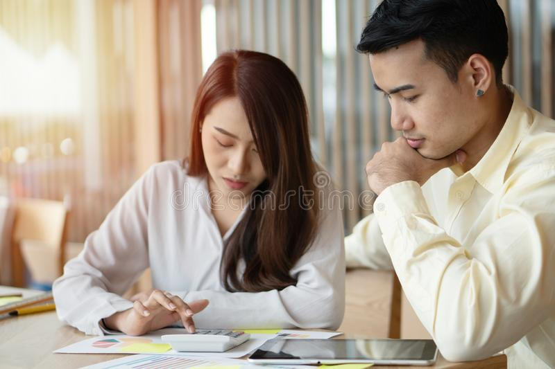 Unhappy Asian couples are calculating income And expenses To cut unnecessary expenses. Concepts for investment planning and financ. Ial planning for the family stock photography