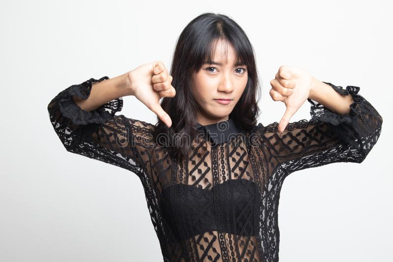 Unhappy Asian girl show thumbs down with both hands. On white background royalty free stock images