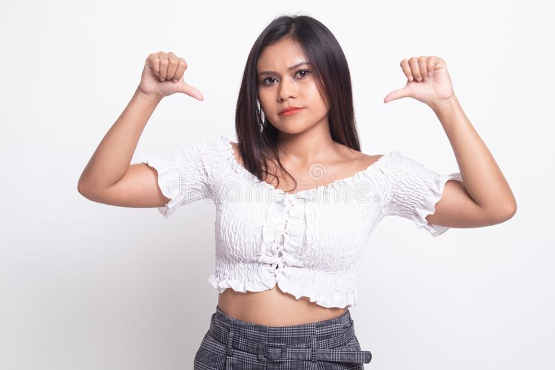 Unhappy Asian girl show thumbs down with both hands. On white background royalty free stock image