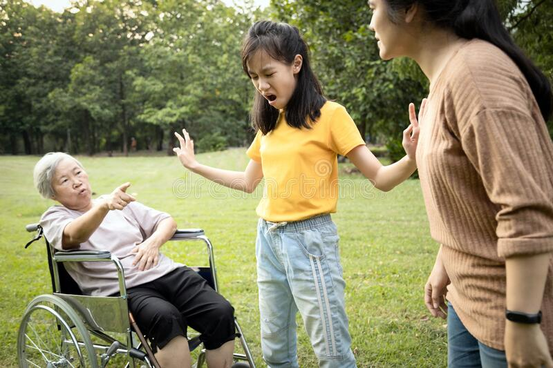 Unhappy asian teen granddaughter dissuade her family from a fight something money,angry senior mother and daughter arguing royalty free stock photos