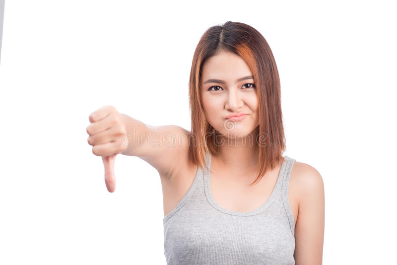 Unhappy asian young woman giving thumbs down gesture looking wit stock photos