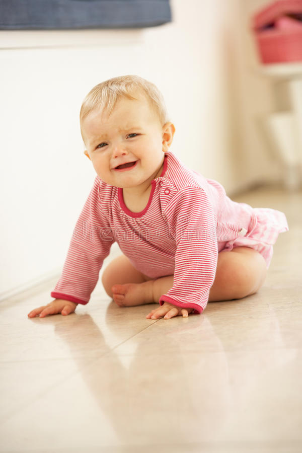 Download Unhappy Baby Girl Sitting On Floor Crying Royalty Free Stock Photography - Image: 26105127