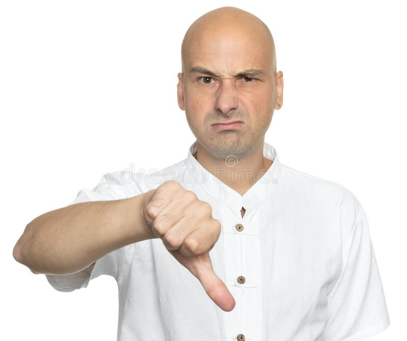 Unhappy bald man showing thumbs down sign royalty free stock photos