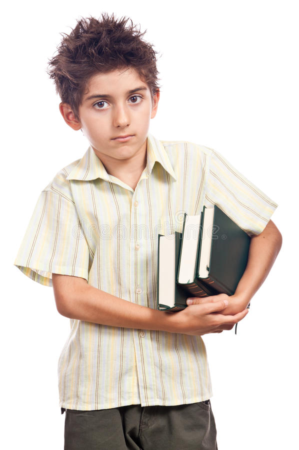Unhappy boy with books