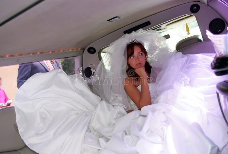 Unhappy bride in Limousine stock photos