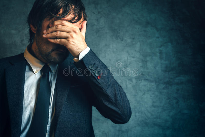 Unhappy businessman under stress after business project failure stock photo
