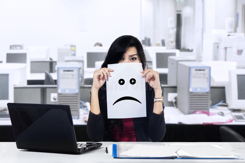 Unhappy businesswoman in the office royalty free stock photos
