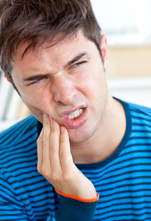 Unhappy Caucasian Man Having A Toothache At Home Royalty Free Stock Photography