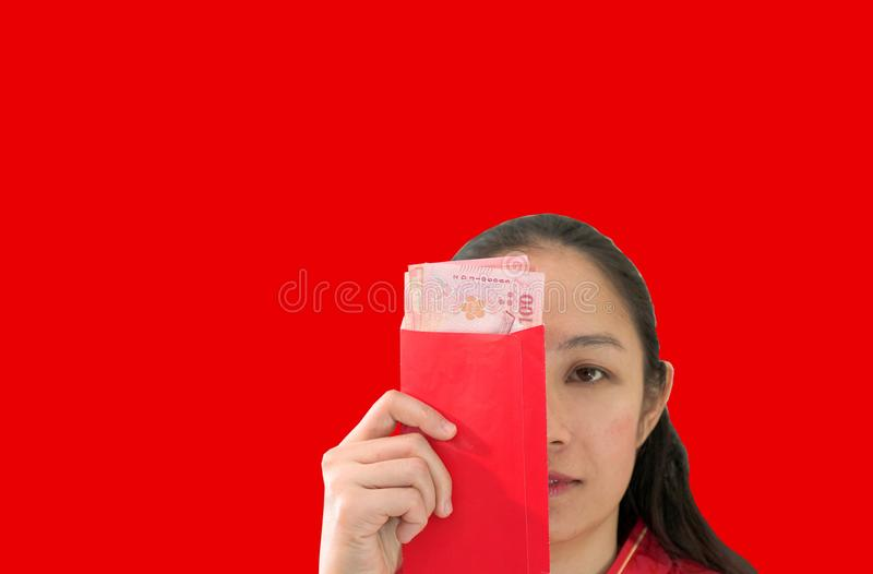 Unhappy Chiense woman red envelop with money New Year stock photo