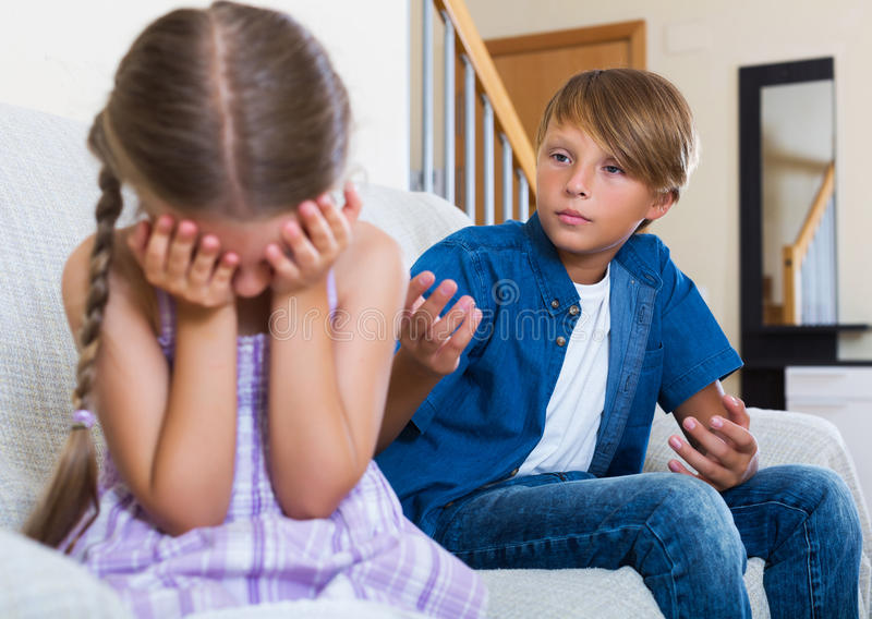 Unhappy children having serious fight stock image