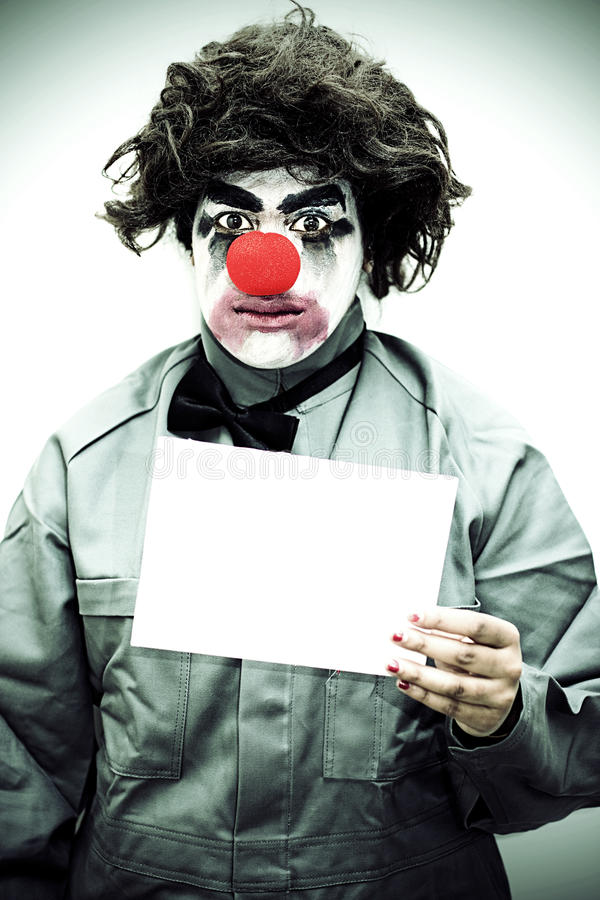 Download Unhappy Clown Holding Sign stock image. Image of expression - 16513601