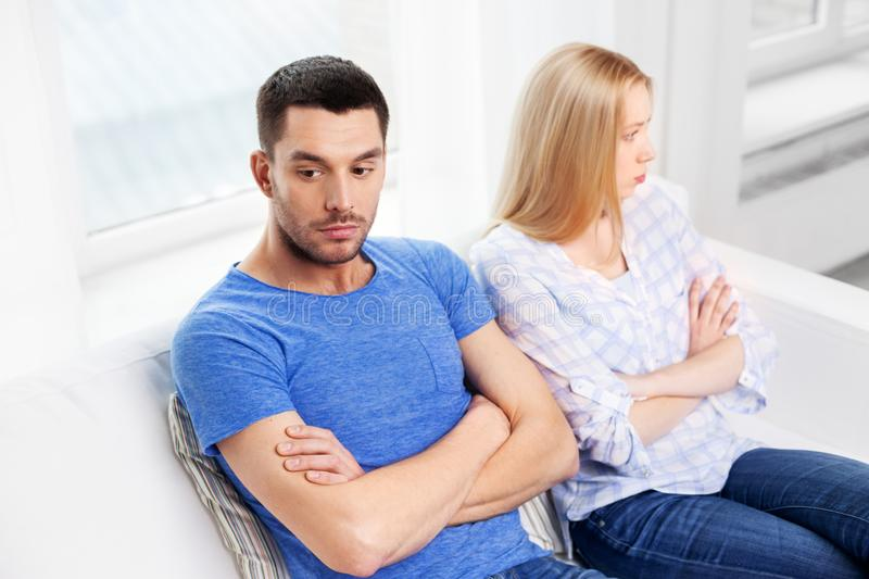 Unhappy couple having argument at home. People, relationship difficulties, conflict and family concept - unhappy couple having argument at home stock images