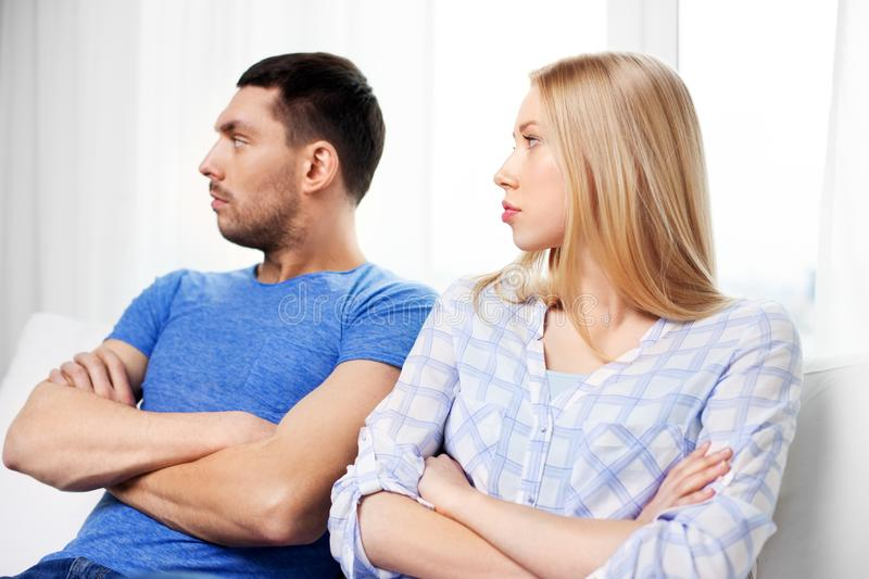 Unhappy couple having argument at home. People, relationship difficulties, conflict and family concept - unhappy couple having argument at home stock image