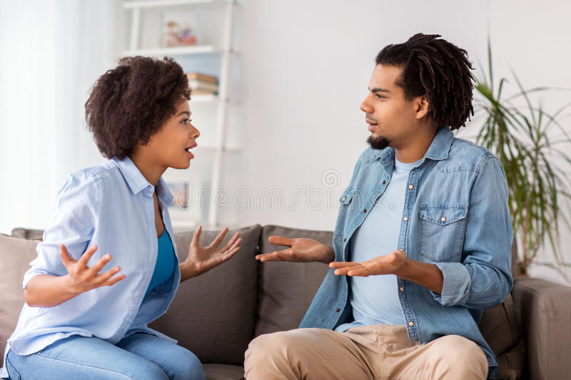 Unhappy couple having argument at home royalty free stock photo